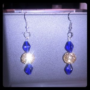 selling beautiful blue with gold color earings